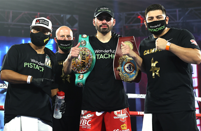 Ramirez celebrates with coach Robert Garcia and his team after victory Photo Credit: Mikey Williams/Top Rank