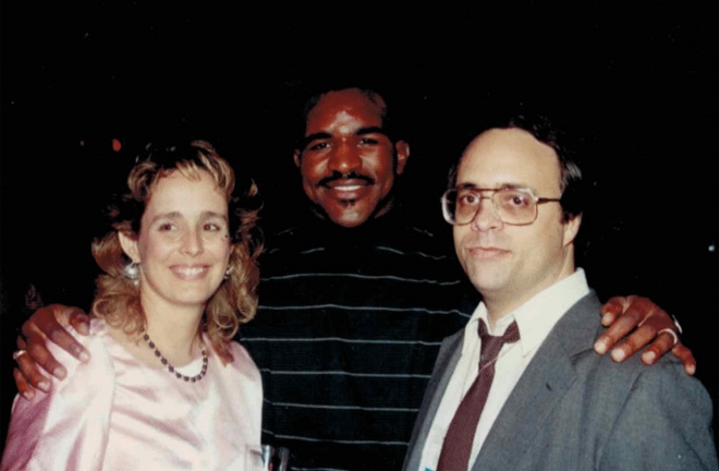 Kathy pictured alongside Evander Holyfield and late husband Dan Duva Photo Credit: Main Events