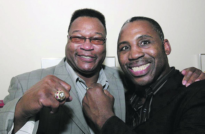 Marvis Frazier and Larry Holmes years after they met in the ring. Photo Credit: The Daily Star