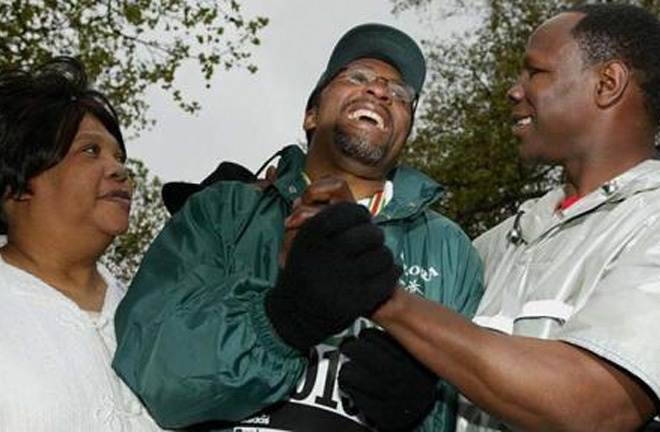 Michael completed the London Marathon in 2003 crossing the finish line with Chris Eubank. Photo Credit: The Telegraph