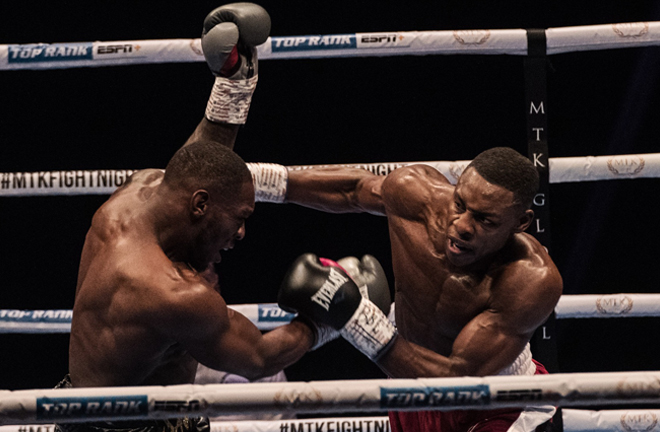 Dan Azeez retained his English title with a ninth round stoppage over Andre Sterling Photo Credit: Scott Rawsthorne / MTK Global