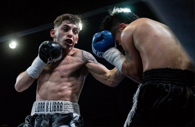 Andre Campos in action delivering a left hand uppercut to his opponent. Photo Credit: Antonio Avilab
