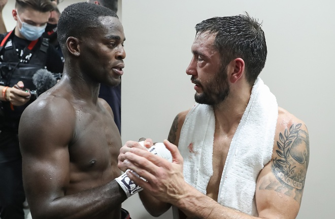 Buatsi and Calic embrace following their frantic battle Photo Credit: Mark Robinson / Matchroom Boxing