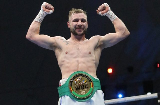 Maxi Hughes secured the WBC International crown with a unanimous decision win over Viktor Kotochigov in Dubai Photo Credit: MTK Global