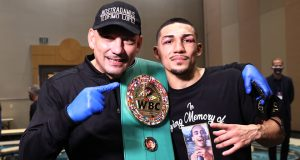 Lopez celebrates with father Teofimo Lopez Sr post-fight Photo Credit: Mikey Williams/Top Rank