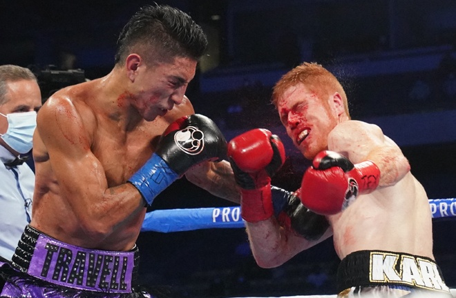 Mario Barrios knocked out the brave and bloodied Ryan Karl to retain his world title Photo Credit: Sean Michael Ham/Mayweather Promotions