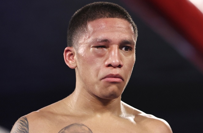 Joshua Franco was unable to continue after suffering an eye injury from what was ruled an Andrew Moloney head clash Photo Credit: Joshua Franco's eye closed from what the referee and video replay officials deemed a headbutt Photo Credit: Please credit Mikey Williams/Top Rank via Getty Images