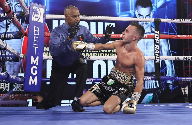 Moloney was knocked down twice before being stopped Photo Credit: Mikey Williams/Top Rank