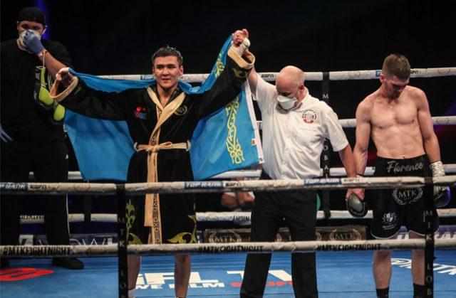 Tursynbay Kulakhmet celebrates after claiming beating a dejected Macaulay McGowan on Wednesday Photo Credit: Scott Rawsthorne/MTK Global
