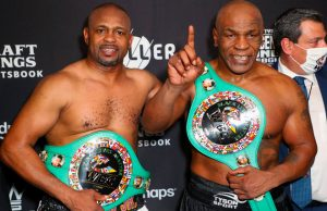 Mike Tyson vs Roy Jones Jr ended in a draw. Both men posed after the bout with their belts following their split draw decision. CREDIT: USA TODAY SPORTS