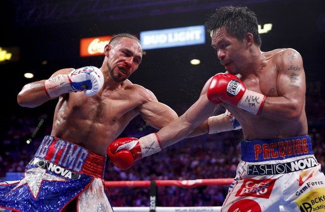 Pacquiao claimed the WBA 'Super' Welterweight crown from Keith Thurman Photo Credit: John Locher / Associated Press