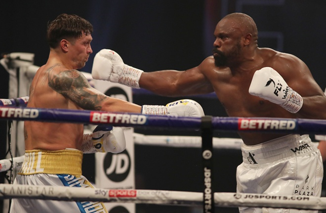 Chisora put the pressure on Usyk in the early stages Photo Credit: Mark Robinson/Matchroom Boxing