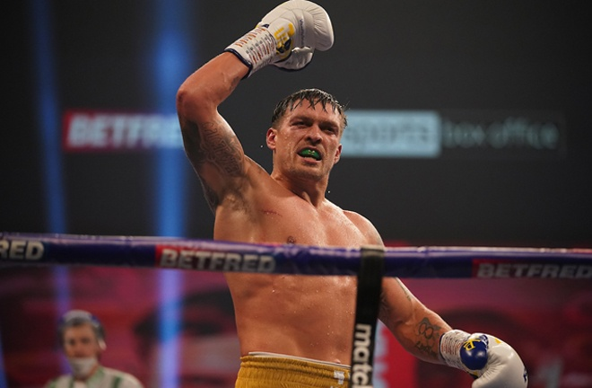 Usyk celebrates after securing a unanimous decision win Photo Credit: Mark Robinson/Matchroom Boxing