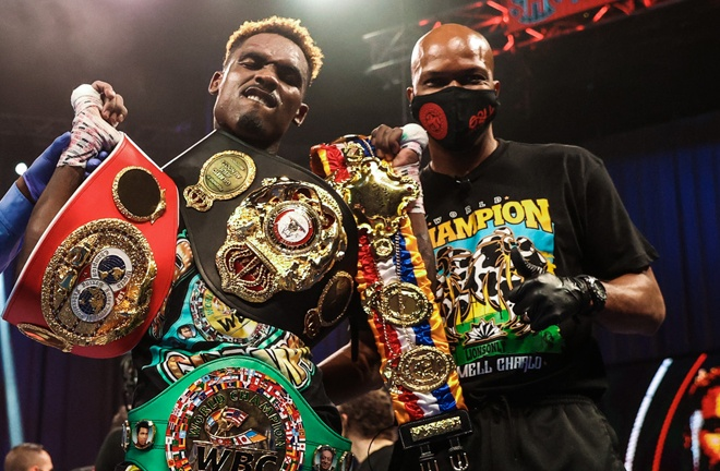 Jermell Charlo hold three of the four world title belts Photo Credit: Amanda Westcott