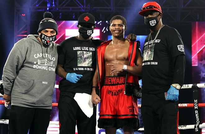 Stevenson celebrates with his team after closing out Top Rank's 2020 schedule Photo Credit: Mikey Williams/Top Rank via Getty Images