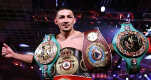 Teofimo Lopez holds the WBA 'Super', IBF, WBO and WBC Franchise belts Photo Credit: Mikey Williams/Top Rank