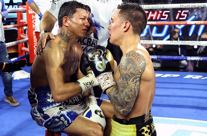 Berchelt and Valdez embrace after their all-action fight Photo Credit: Mikey Williams/Top Rank via Getty Images