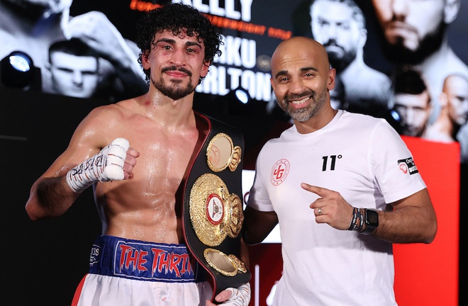 Gill celebrates with trainer Dave Coldwell Photo Credit: Mark Robinson/Matchroom Boxing