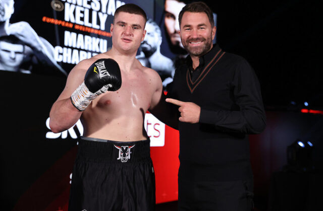 Johnny Fisher celebrates alongside promoter Eddie Hearn after securing a first professional win on Saturday Photo Credit: Mark Robinson/Matchroom Boxing