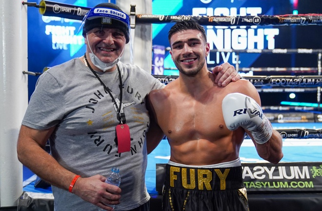 Tommy Fury celebrates with father, John Fury after picking up his fifth professional win in emphatic fashion Photo Credit: Round 'N' Bout Media/Queensberry Promotions