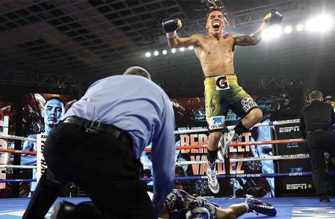 Valdez celebrates after his stunning win to become a two-weight world champion Photo Credit: Mikey Williams/Top Rank via Getty Images