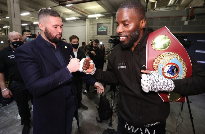 Okolie embraced with former WBC cruiserweight champion, Tony Bellew after becoming world champion Photo Credit: Mark Robinson/Matchroom Boxing
