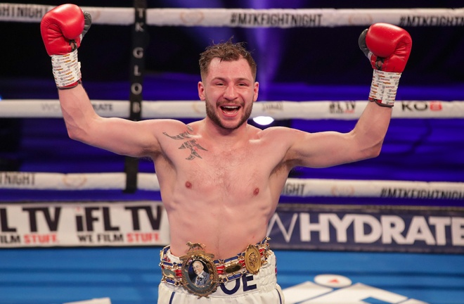 Maxi Hughes was left elated after claiming the British Lightweight title Photo Credit: Scott Rawsthorne/MTK Global