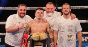 Lee McGregor celebrates with his team including trainer Ben Davison after winning the European Bantamweight title on Friday Photo Credit: Scott Rawsthorne/MTK Global