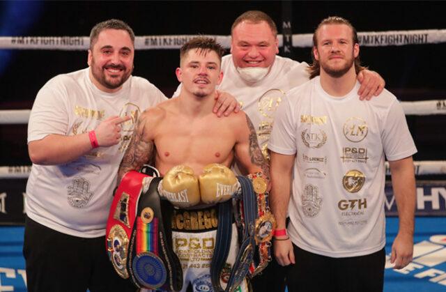 Lee McGregor celebrates with his team including trainer Ben Davison after winning the European Bantamweight title on Friday Photo Credit: Scott Rawsthorne/MTK Global