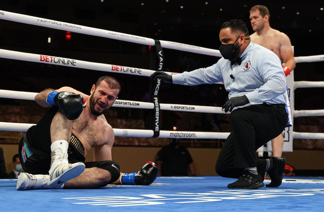 Majidov appeared to be in some discomfort holding his ankle after dropping to the canvas Photo Credit: Ed Mulholland/Matchroom