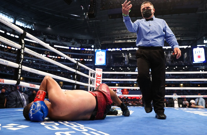Aguilera winced in pain on the canvas and complained that he had been hit to the back of the head Photo Credit: Ed Mulholland/Matchroom