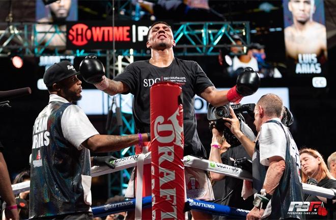 Luis Arias celebrates after defeating Jarrett Hurd Photo Credit: Pro Boxing Fans