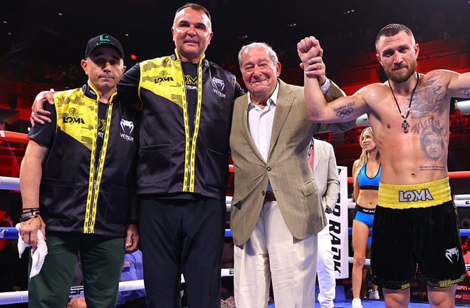 Lomachenko celebrates with his father (far left), manager Egis Klimas (centre left) and promoter Bob Arum (centre right) Photo Credit: Mikey Williams/Top Rank via Getty Images
