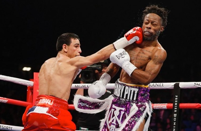 Ouballi (left) catching Rau'shee Warren with a right hand. Photo Credit: Showtime Boxing