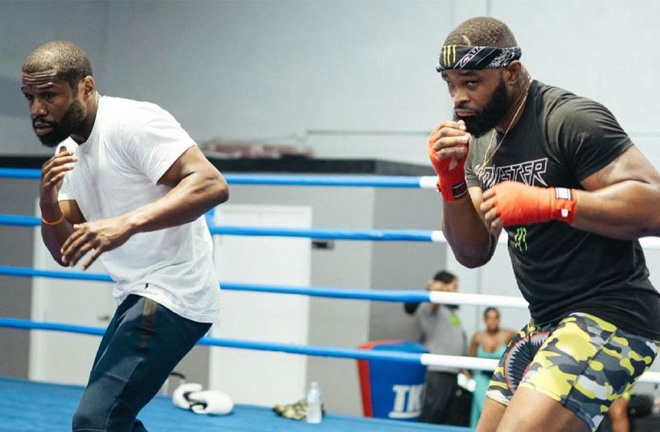 Woodley spent some time training with Hall of Famer, Floyd Mayweather Jr Photo Credit: Instagram @twooodley