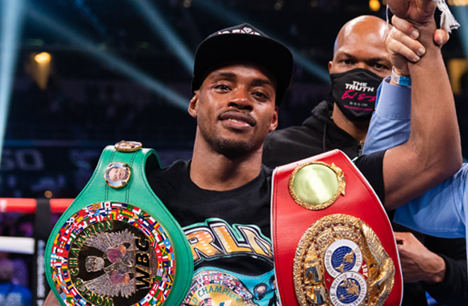 Spence holds the WBC and IBF belts Photo Credit: Ryan Hafey / Premier Boxing Champions