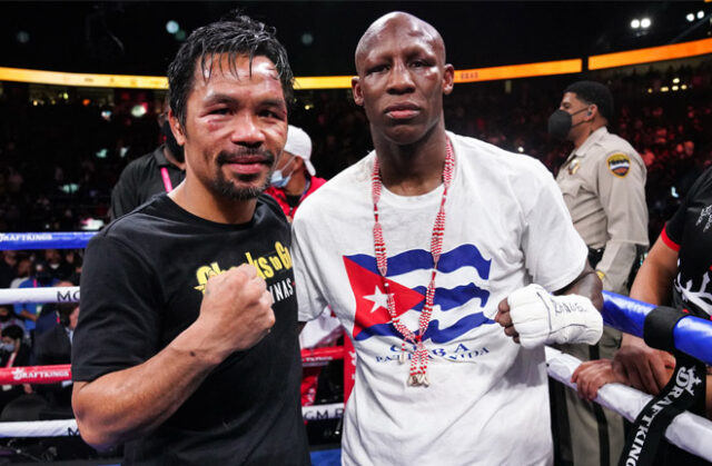 Yordenis Ugas and Manny Pacquiao embraced after their fight in Las Vegas on Saturday night Photo Credit: Sean Michael Ham/TGB Promotions